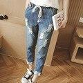 Лето большой размер джинсы женщина жира сестра полосатый отверстие девять очков брюки веревки упругих тонких брюки отверстия джинсы женщина XL 5XL