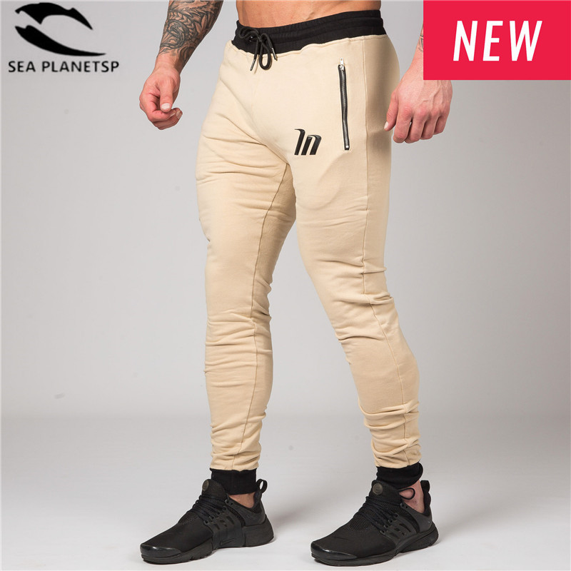 2018 New casual pants Jogger Pants Men Bodybuilding Pants Gyms Runners Clothing Autumn Sweat Trousers Zip pocket men Sweatpants