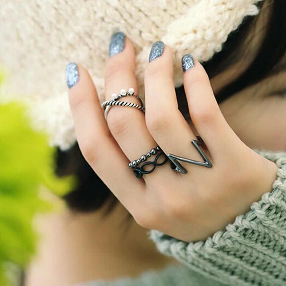 ใหม่เหนือวงMidi K Nuckleแหวนเครื่องประดับแฟชั่น4ชิ้น/เซ็ตสีดำสีเงินชุบพังก์แหวนแฟชั่นสำหรับผู้หญิงGrils