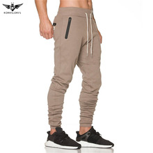 Фотография KORKSLORES New Men pocket zipper sportswear Pants Casual Elastic Waist GYMS Fitness Workout Trousers skinny Sweatpants Jogger