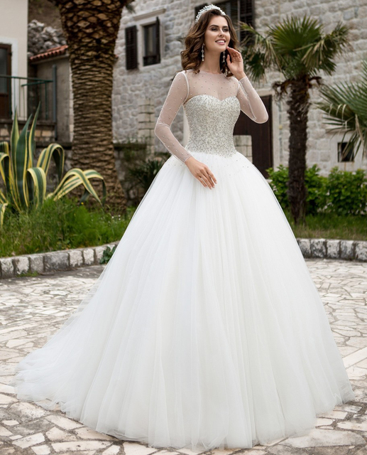 Luxury Crystal Princess Wedding Dress Sheer Neckline Beaded Puffy ...