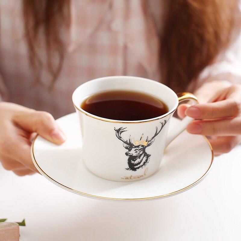 Estilo nórdico zebra elk hueso China taza de café y platillo conjuntos inglés de alta calidad phlum penh negro taza de té regalo envío Gratis Novedad de 304, escurridor de platos de cocina de acero inoxidable, escurridor de platos y cubiertos, escurreplatos, soporte de almacenamiento organizador de cocina de montaje en pared