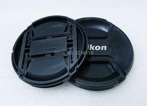 Image 2 - 100 pcs Camera Lens Cap capa 49mm 52 72 67 62 58 55mm mm mm mm mm mm 77mm 82mm LOGO Para Nikon (observe o tamanho)