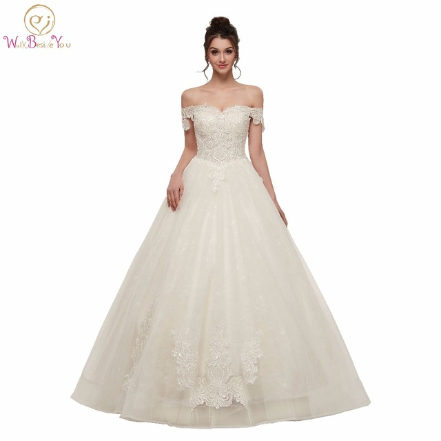 d41af26a03ca Walk Beside You Off Shoulder Wedding Dresses High Quality Lace Applique  Transparent White Ivory Ball Gown Bridal Gowns 2019