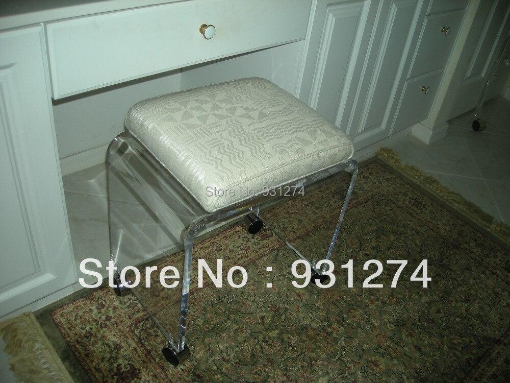 Un lux elegante acrilico vanity sgabello con rotelle rotolamento