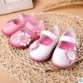 Venta caliente heatnice El nuevo retail zapatos de bebé zapatos de las mujeres arco de Corea flor de los bebés niño antideslizante zapatos al por mayor nueva arr