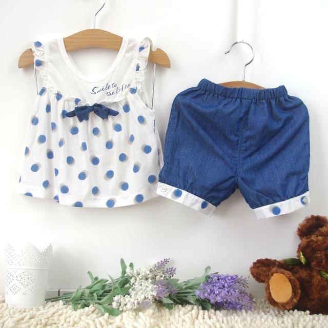 2016 Verão conjunto menina ternos de algodão Doce dot mangas Ruffled tops + shorts Da Menina Das Crianças 2 pcs Outfits Roupas arcos garoto Conjunto