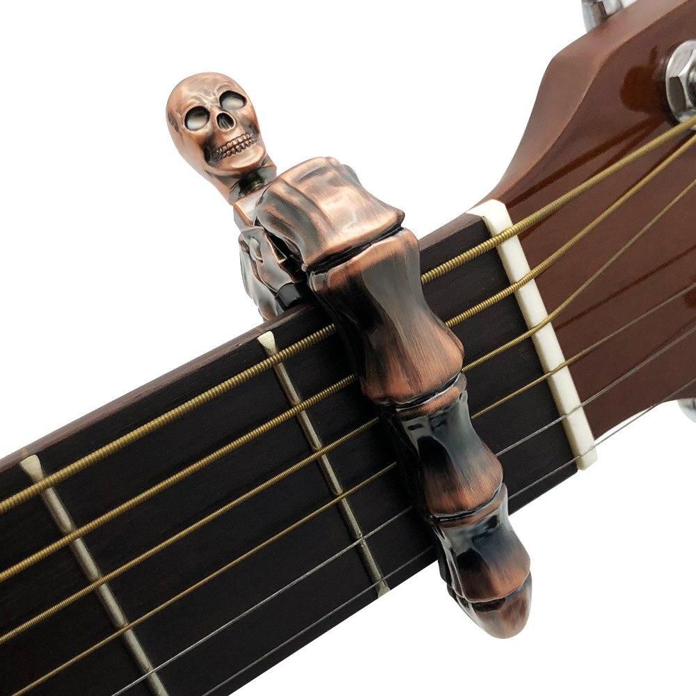 SLOZZ Crânio 6 String Guitar Capo Capotraste Guitarra Acústica Clássica Guitarra Elétrica Baixo Acessórios de Metal Dedo Osso