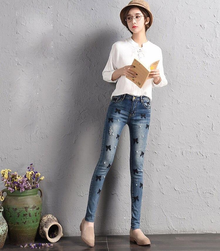 e6fa73165 Pantalones pitillo de mezclilla Vintage de nueva moda para mujer 2018  primavera verano caliente Casual estilo Preppy bordado bengalas rasgadas  Jeans