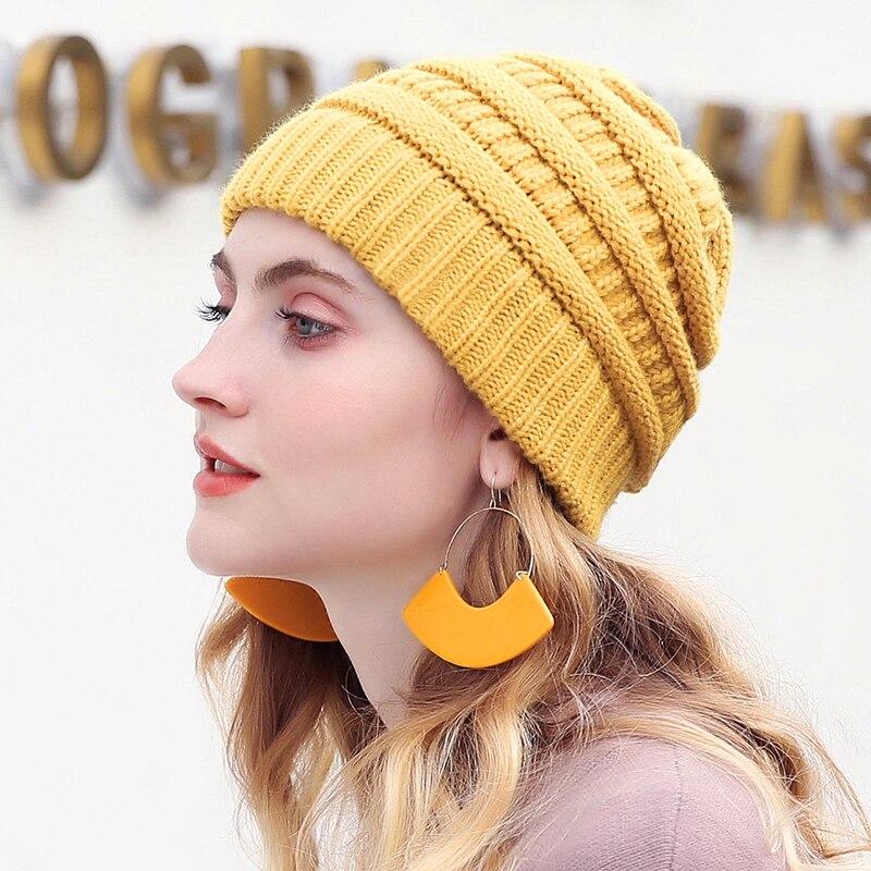 Envío de la gota 2018 sello gorros de invierno sombreros para las mujeres  de punto sombrero con etiqueta caliente pantalones Stretch de punto grueso  Cable ... 69c35c8a129