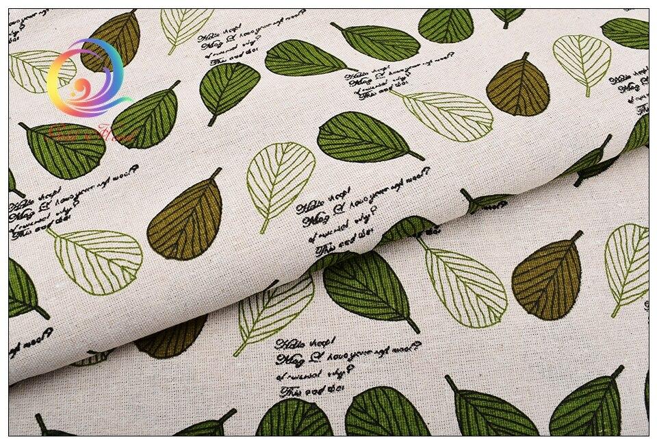 Valge kangas roheliste lehtedega