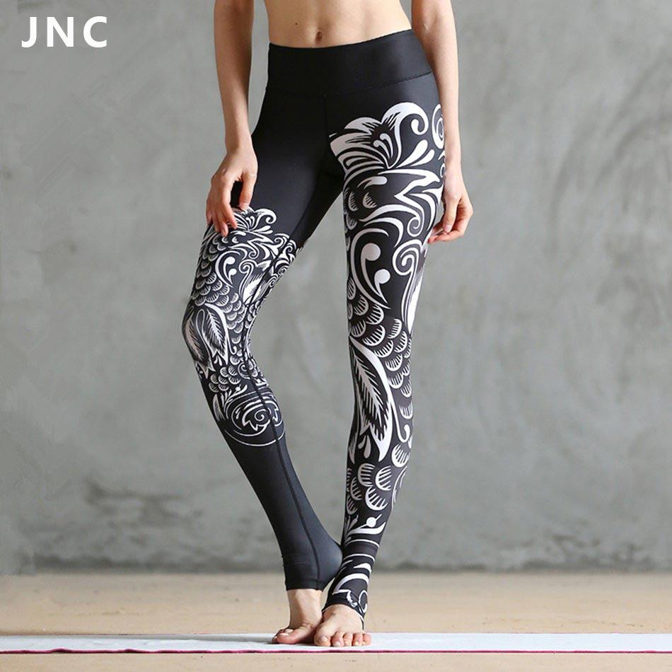 JNC Women Black Printed Ployster Yoga Leggings Goddess