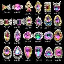 100 adet/paket yeni holografik tırnak kristal yüksek kaliteli AB Rhinestone alaşım Nail Art süslemeleri Glitter Charm 3D tırnak mücevheri