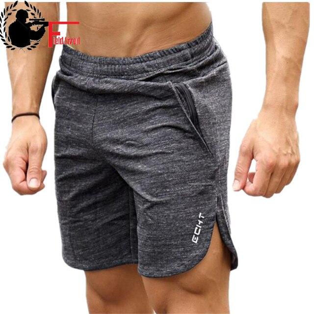 Encalhar GINÁSIOS Esportivos ROUPAS de Moda Masculina Quente Algodão  Musculação Crossfit Fitness Jogger Shorts Homens Bermuda 106af7f401777