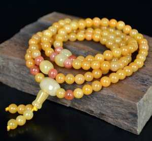 Hagit- Xinjiang natural gold silk jade bracelet new fashion gobi jade.