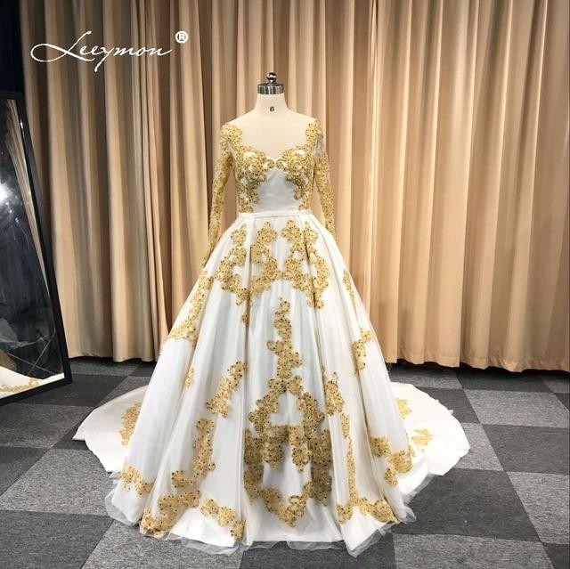 Leeymon Custom Made Muslim Wedding Dress In Dubai White and Gold Lace Long  Sleeves Wedding Gown Beaded Vestido De Noiva 2019 1240669adc77