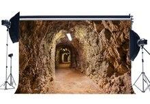 Подземный пассаж фон западный ковбой фоны выветренный старый рок камни лампа гранж фон для фотосъемки