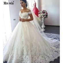 2020 יוקרה תחרת סירת צוואר כדור שמלת חתונת שמלות מתוקה Sheer חזרה נסיכת אשליה Applique כלה שמלות Casamento