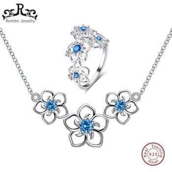 c9338e63a943 Rinntin 100% Real 925 plata esterlina de la joyería de las mujeres conjunto  lindo diseño de la flor de circón AAA fiesta anillos collares conjuntos de  joyas ...