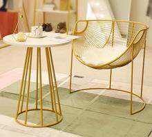 лучшая цена Showcase rack simple landing women's clothing store lounge area tea table table chair golden leisure chair