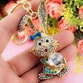 Bowknot encantadora Del Conejo de Cristal Bolsa de diamantes de Imitación Colgante llaveros Titular mujeres de Joyería de Moda Llavero Llavero De Coche K184