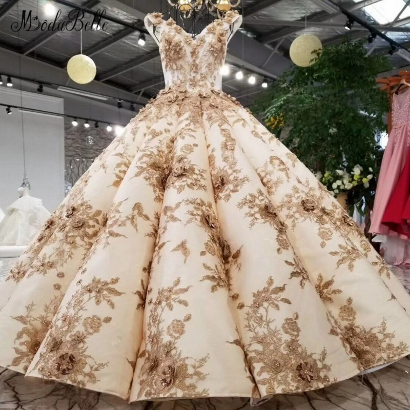 e7982d19bb17 Modabelle Deluxe Champagne Gold Bridal Wedding Dress 3D Flower Robe De  Mariee Pearls Embroidery Backless V Neck Ball Gown 2018