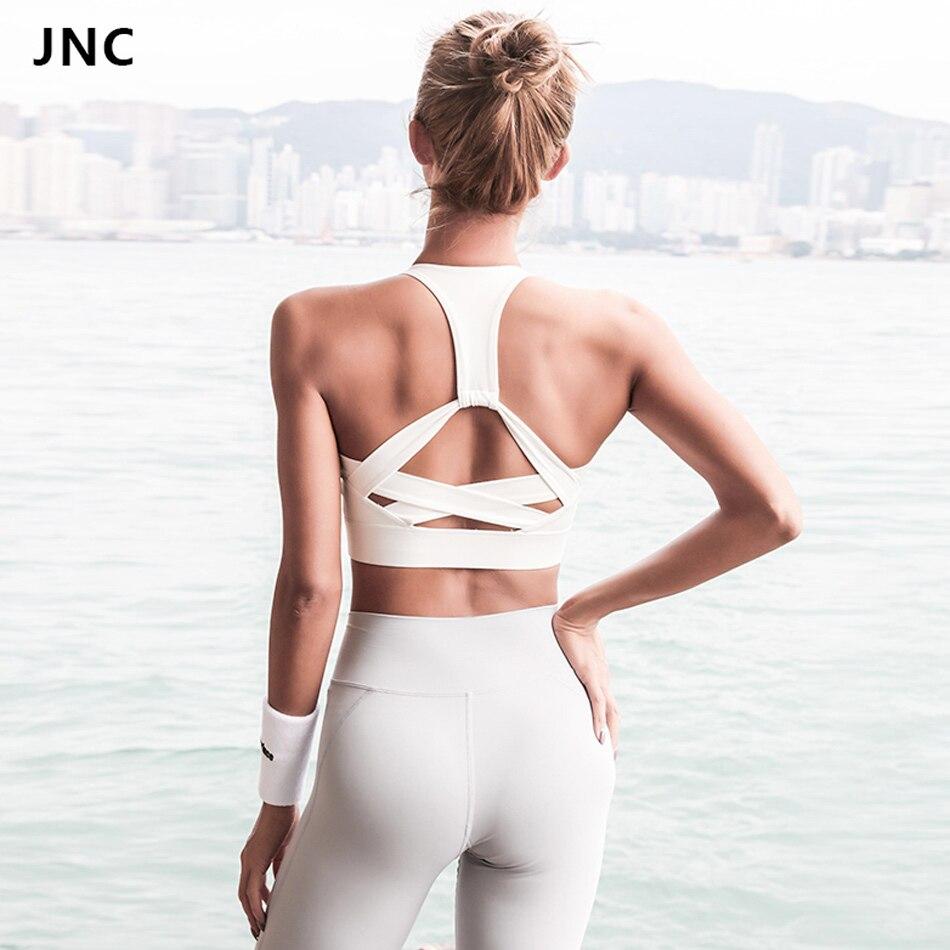 JNC 2018 nuevo estilo blanco Correa Push Up Sujetador deportivo para las mujeres Gym Running Padded Bra Athletic Vest Hollow out ropa interior deportiva