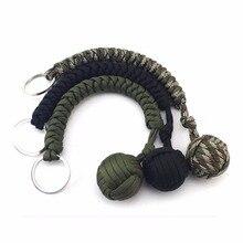 купить Stainless Steel Ball Pendant Paracord Parachute Cord Key Chain Outdoor Climbing Umbrella Rope Survival Kits 1PC по цене 272.9 рублей