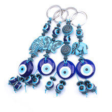 1pc turkey evil eye blue keychain 4 style resin animal fish elephant butterfly 14mm evil eye blue beads with glass round eye key(China)