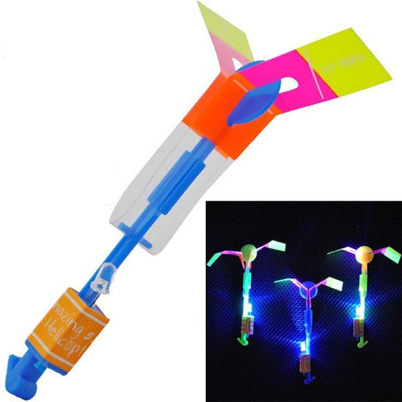 Горячий магия стрейч флэш-Сияющий Ракеты Игрушка резинкой летать стрелка вертолет неоновый свет детей Детские игрушки