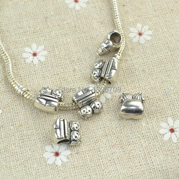 bbad3824fd13 Al por mayor 50 unids lote antiguo plata grandes encantos del agujero granos  flojos para las pulseras europeas haciendo joyería DIY z42393