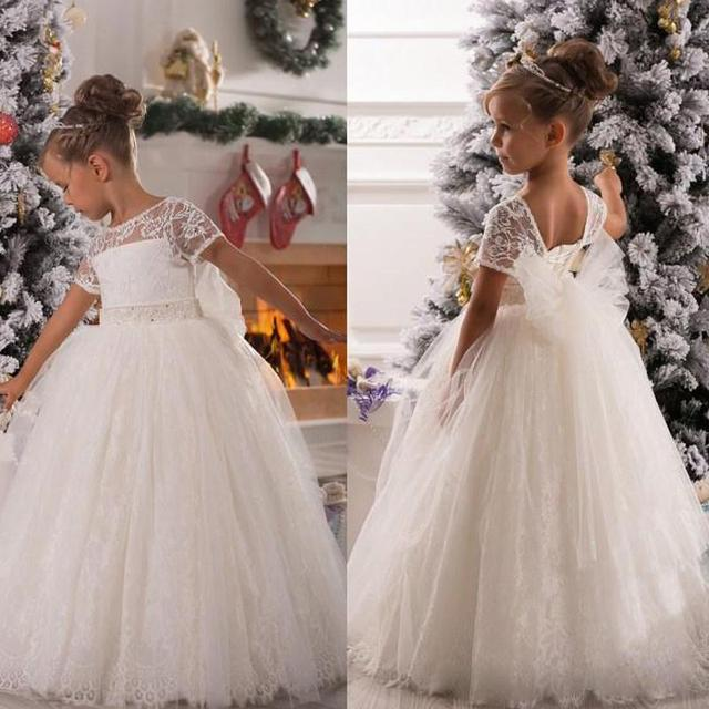 4f0badab0f Hot Selling Ivory Ball Gown Flower Girls Dresses 2017 Illusion Lace Boat  Neck Short Sleeves Beaded Belt Birthday Christmas Gowns