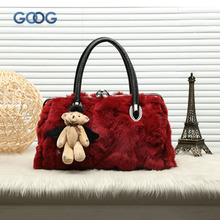 Autumn and winter new rabbit fur fur head layer of cowboy fashion female handbag shoulder diagonal twist hair package leather ha