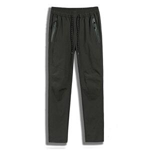 7XL 8XL мужские спортивные штаны большого размера, быстросохнущие брюки с карманами на молнии, мужские спортивные брюки для тренировок на откр...
