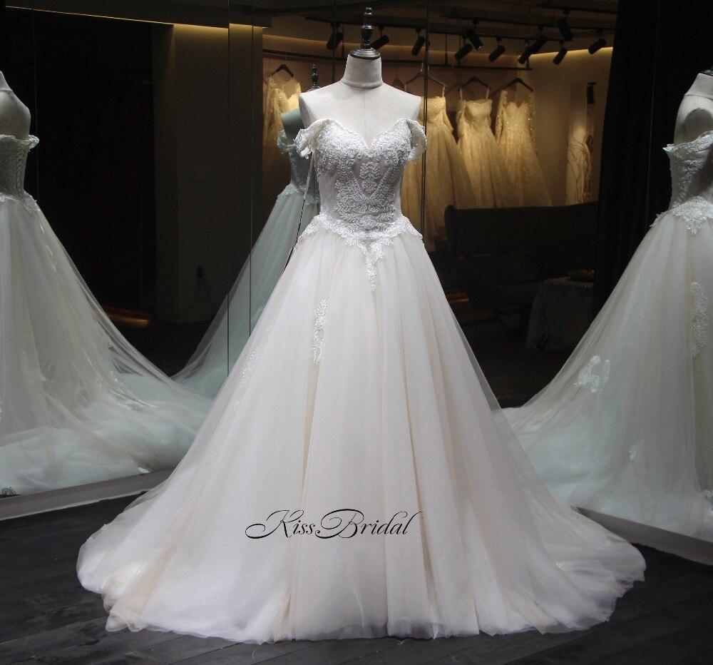 Baru Kedatangan Gaun Pengantin 2018 Sayang Leher Cap Lengan Panjang Chapel  Kereta A Line Appliques Lace Tulle Bride Gaun Casamento di Wedding Dresses  dari ... 7be3442cc921