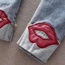 Red Lips Washed Ripped Denim Slim Jeans