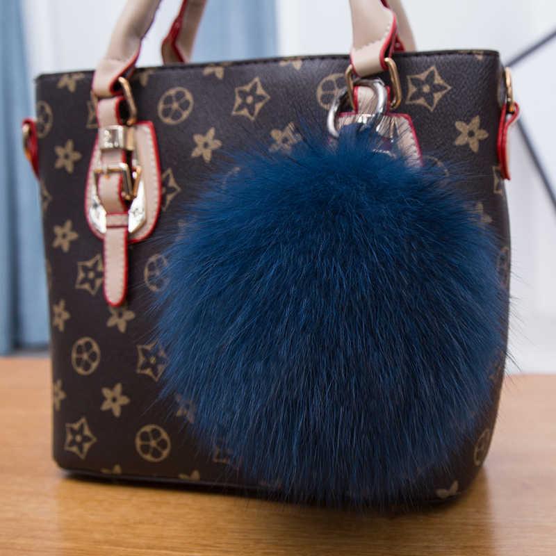 2018 Moda 15 cm Fluffy Bola Chaveiro de Couro Real de Pele De Guaxinim-fox Chaveiro Pompom Pompom das Mulheres Chaveiro CharmBag pingente