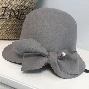 Image 3 - אלגנטי פורמליות נשים צמר כובע חם הרגיש חורף פדורה כובע פרל Bowknot הקלוש Bowler כובע גבירותיי המפלגה דרבי כנסיית חתונה כובע
