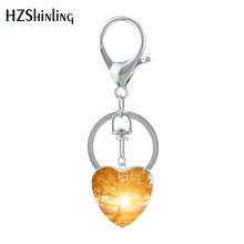 HZSHINLING Classic Life of Tree Theme Real Tree and Sunset in Land Heart Shaped Keyring Glass Pattern Keychain Jewelry(China)