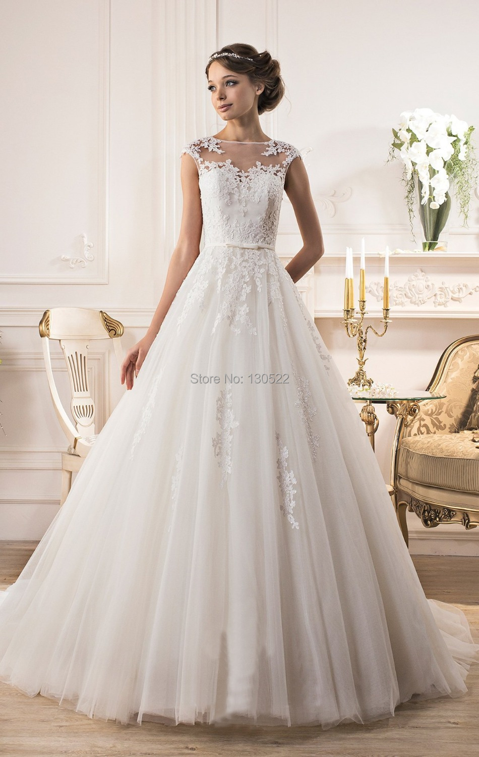 Lace top wedding dress with cap sleeve