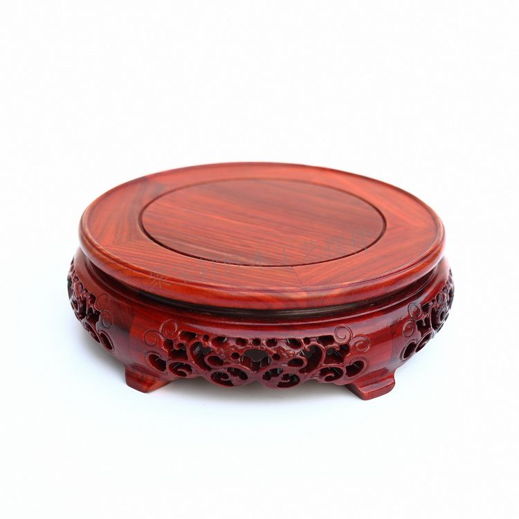 Red wingceltis of solid wood carving round base household act the role ofing is tasted annatto handicraft furnishing articles