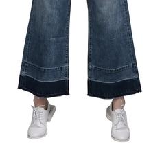 بنطلون جينز واسع الساق عالي الخصر بتصميم مميز