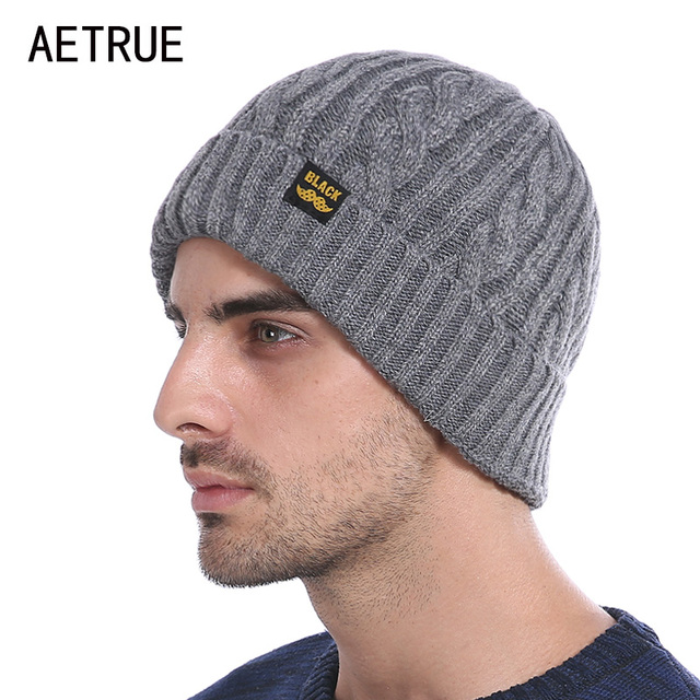 Canadian man wearing a beanie style tuque The precursor to the modern tuque was a small, round, close-fitting hat, brimless or with a small brim known as a Monmouth cap. In the 12th and 13th centuries, women wore embroidered