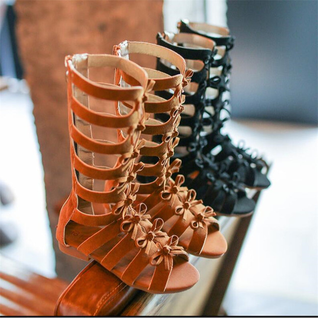 Verano 2019 nueva versión europea de los zapatos de los niños sandalias de cabeza de pez huecas de las muchachas romanas de Punta abierta de moda tubo alto fresco botas