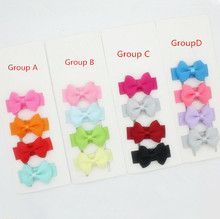 цена на Free shipping 300pcs  Baby Hair Bows Pinched Bows On Mini Snap Clips for Fine Hair