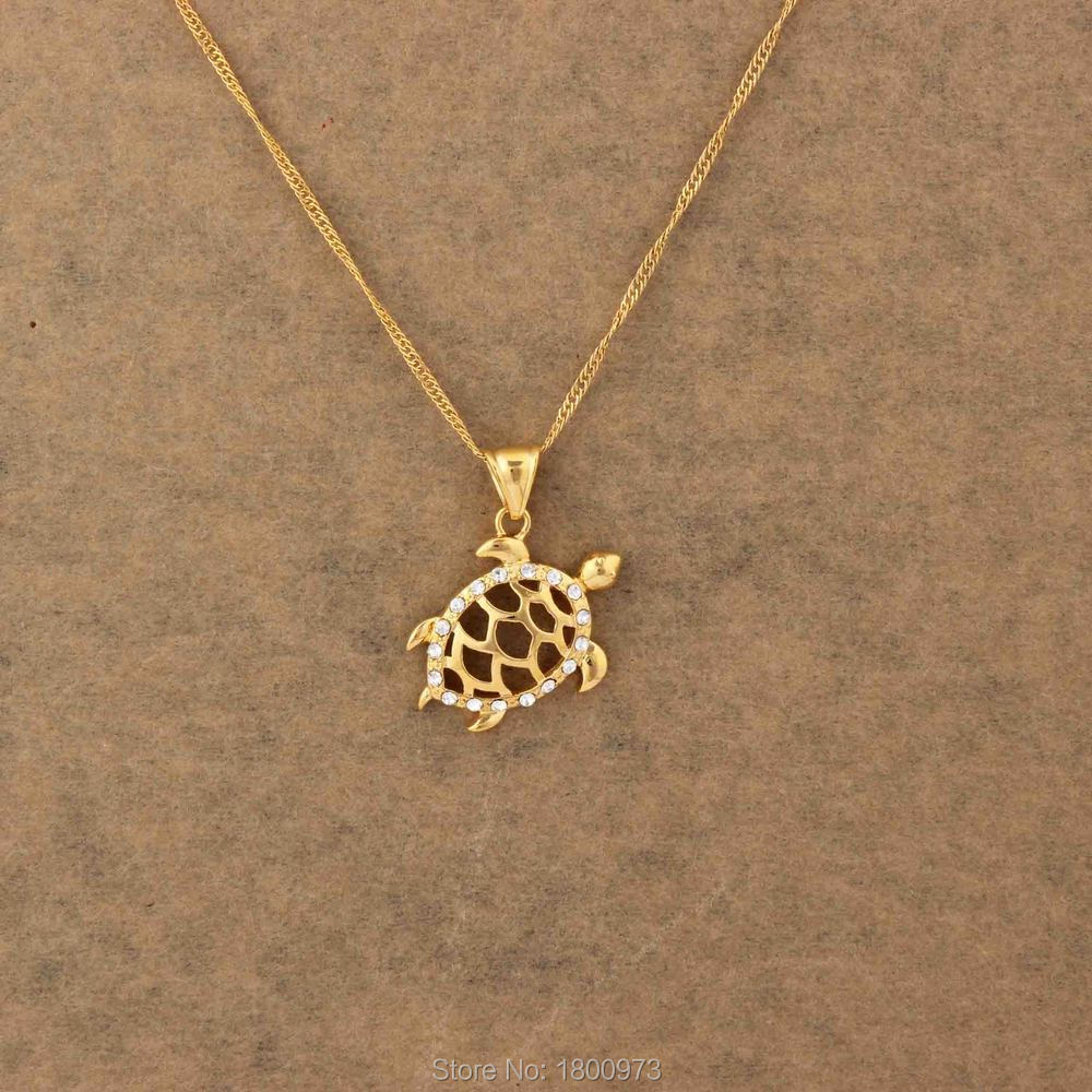 moving pin or tortoise pendant and charm pendants gold
