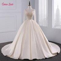 TaooZor Luxurious Light Champagne Satin Ball Gown Wedding Dress Bling Beaded Bodice Sexy Tulle Neckline Vestidos De Noiva