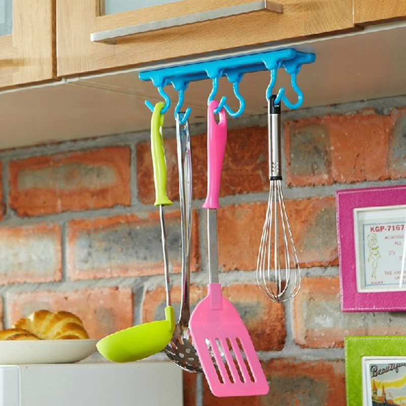 I used a hanging jewelry organizer as a cute, inexpensive ...