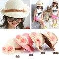 Девушки летний ребенок соломенные шляпы 2016 мода большой цветок шапки шапочка уф защита от солнца флоппи-бич шляпа