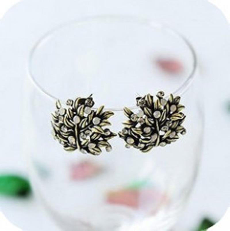 471123ae8621 Joyería fina de Europa y América pendientes de cristal exuberante follaje  pendientes retro del oído joyería de moda pendientes de cristal